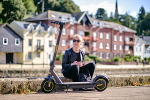 Woman resting with the Ampere Go Electric Scooter